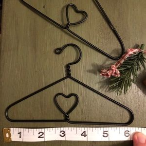 Two small decorative hangers